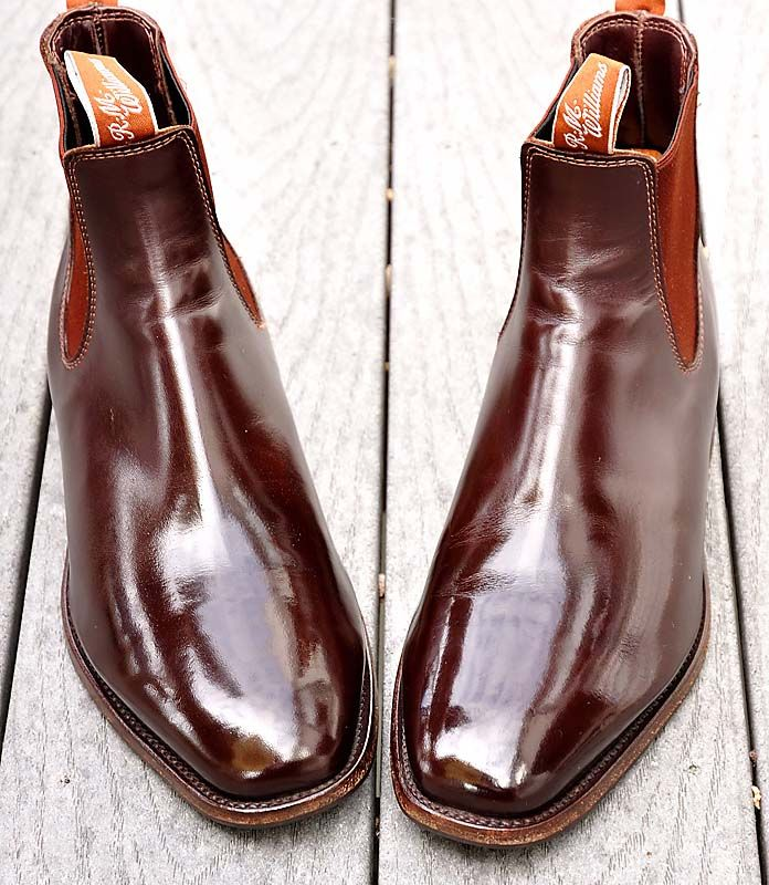How does a person shine boots?