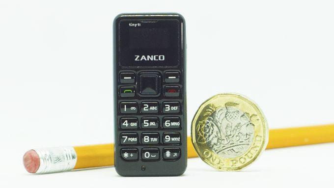 The Zanco tiny t1 in comparison to a coin and pencil