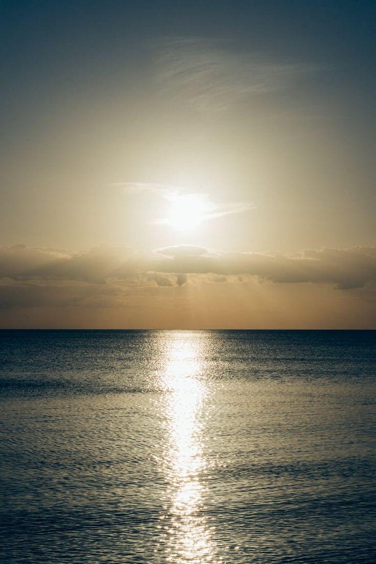 Calm Sea With Sun Setting Photo