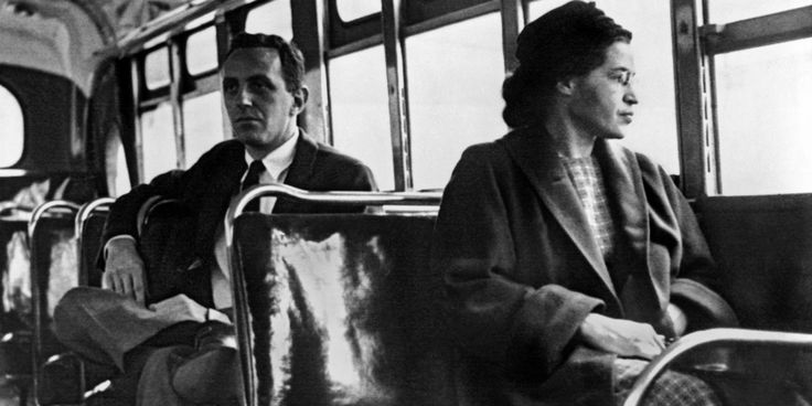 Rosa Parks sits in the front of a bus in Montgomery, Alabama, in 1956.