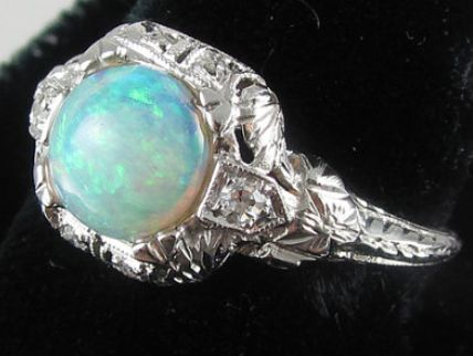 Edwardian Art Deco filigree 18k white gold .80 ct. opal diamond ring. Via Diamonds in the Library.