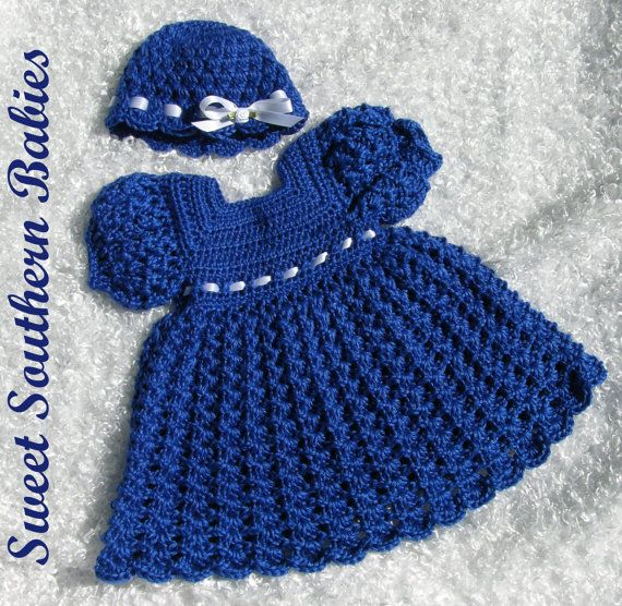 Your new baby will feel like royalty in this silky ensemble. This dress is made with a soft silky yarn and embellished with pearl buttons for the back closure. The hat is trimmed with a satin ribbon Hand wash - Dissolve mild detergent in lukewarm water. Place the item in the suds and squeeze gently. Do not rub or leave to soak. Rinse twice in clean, lukewarm water. Remove excess moisture by rolling in a thick towel.  Lay flat to dry - do not wring, twist or hang to dry. Lay item on a flat…