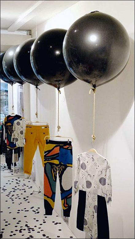 Balloon Based Merchandising Display with Fishing Line
