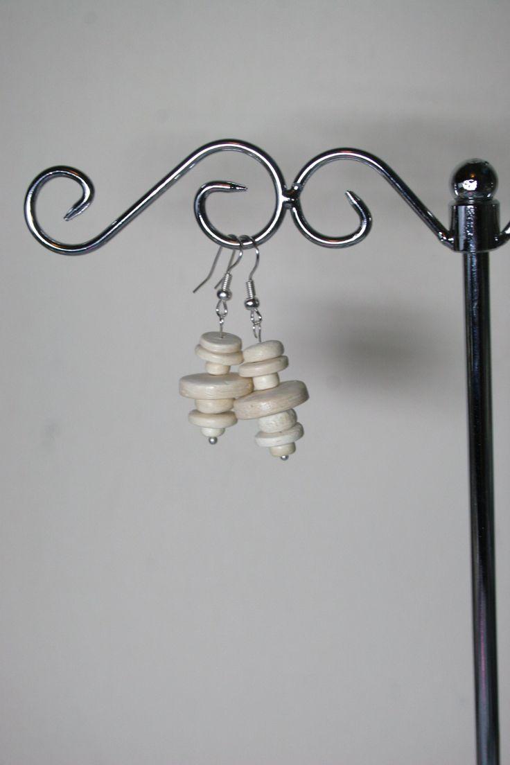 White wooden circular earrings  www.facebook.com/Supposejewellery