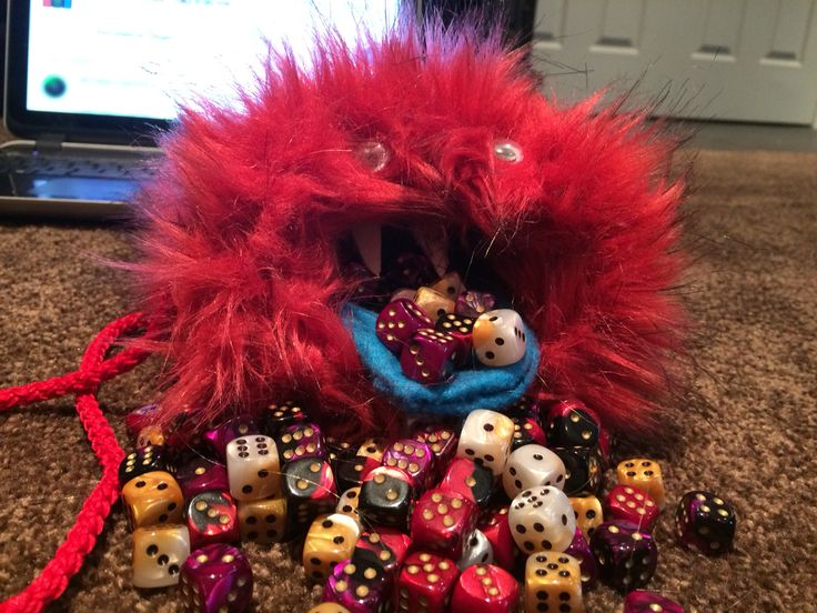 I had fur scraps and dice that needed a home. So I made this monster dice bag to keep my dice warm in his belly