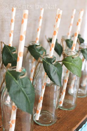 Africa Safari Madagascar Animal Movie Themed First Birthday Party: IDEA-tie leaves to the drinking glasses with the rustic feel of twine.