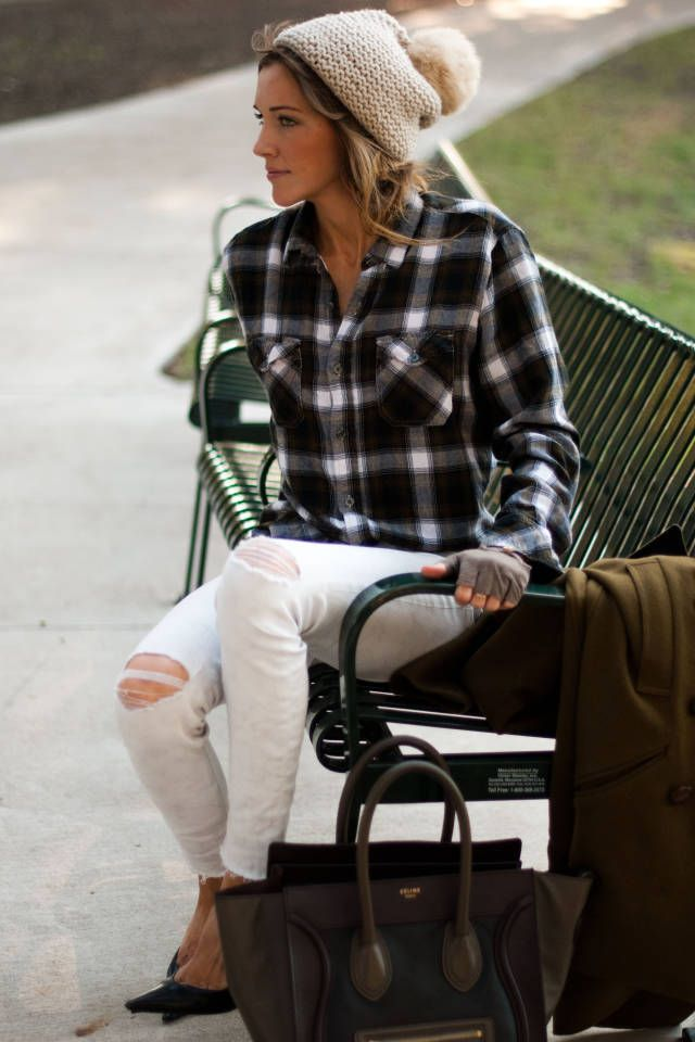 White pants , flannel , and a beanie with a pompom on top !