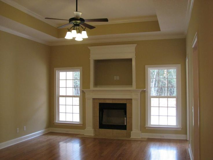 framed fireplace with tile surround u0026 tray ceiling with molding