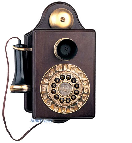 The Antique Wall 1903 is a reproduction wood wall phone with a genuine metal antique brass bell, handset hook and touchtone dial.  This telephone features an old style cloth handset cord, push button dialing, a last number redial button and high / low receiver and ringer volume control.