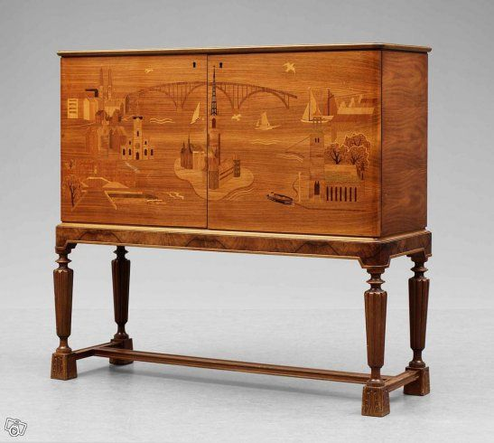 Superb Swedish craftwork, Cabinet furniture made in the beginning of the 1940s, with original drawing of the intarsia inlaying at the front and different woods used.The intarsia picturing Stockholm Skyline and classical symbols of Stockholm. Cabinet designed by Swedish Arhitect Erik Matsson. Dimensions: 125 cm x 115 cm x 41 cm. In very good condition: Contact:hans.borgelin@tele2.se