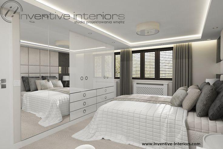 Projekt sypialni Inventive Interiors - biała luksusowa szafa na wysoki połysk z dużymi lustrami, odkrytymi szufladami i dekoracyjnymi uchwytami