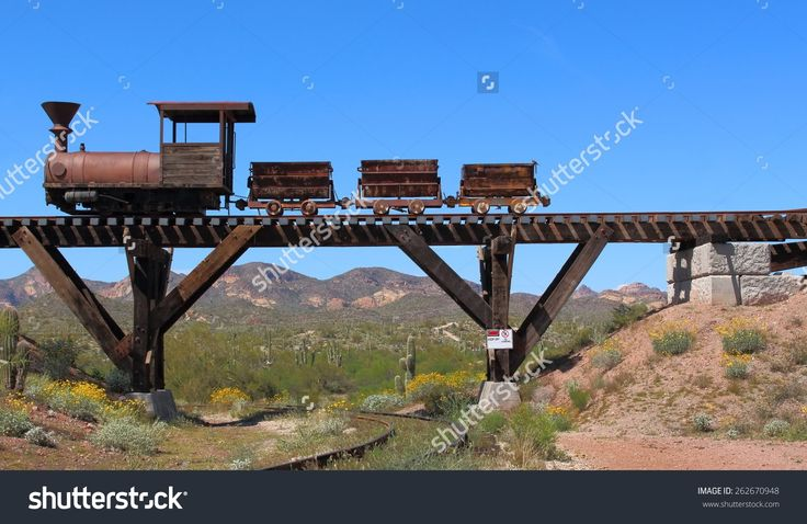 stock-photo-old-wild-west-train-with-mining-carts-passing-over-an-old-wooden-bridge-with-mountains-cactus-and-262670948.jpg (1500×975)