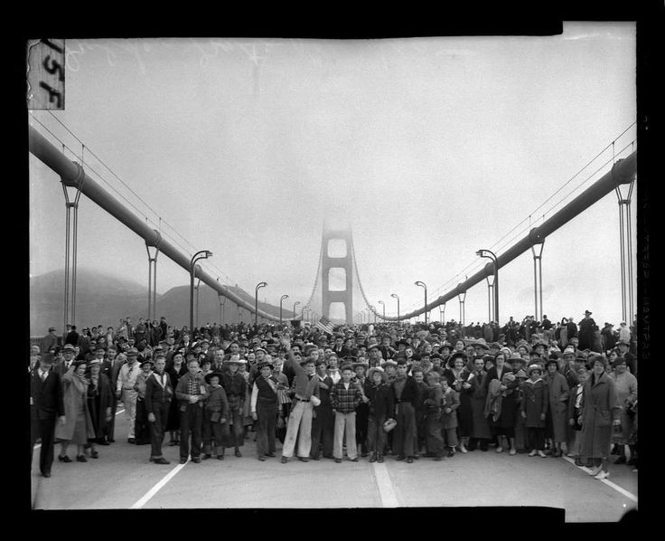 Pedestrians walk across the Golden Gate Bridge on May 27, 1937. San Francisco Chronicle archive photo. Photo: Chronicle File, San Francisco Chronicle