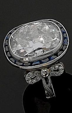 An Art Deco platinum, diamond and sapphire ring, circa 1920. Centring a large diamond weighing about 10 carats, framed by calibré sapphires and set with old-cut diamonds, mounted in platinum. #ArtDeco #ring