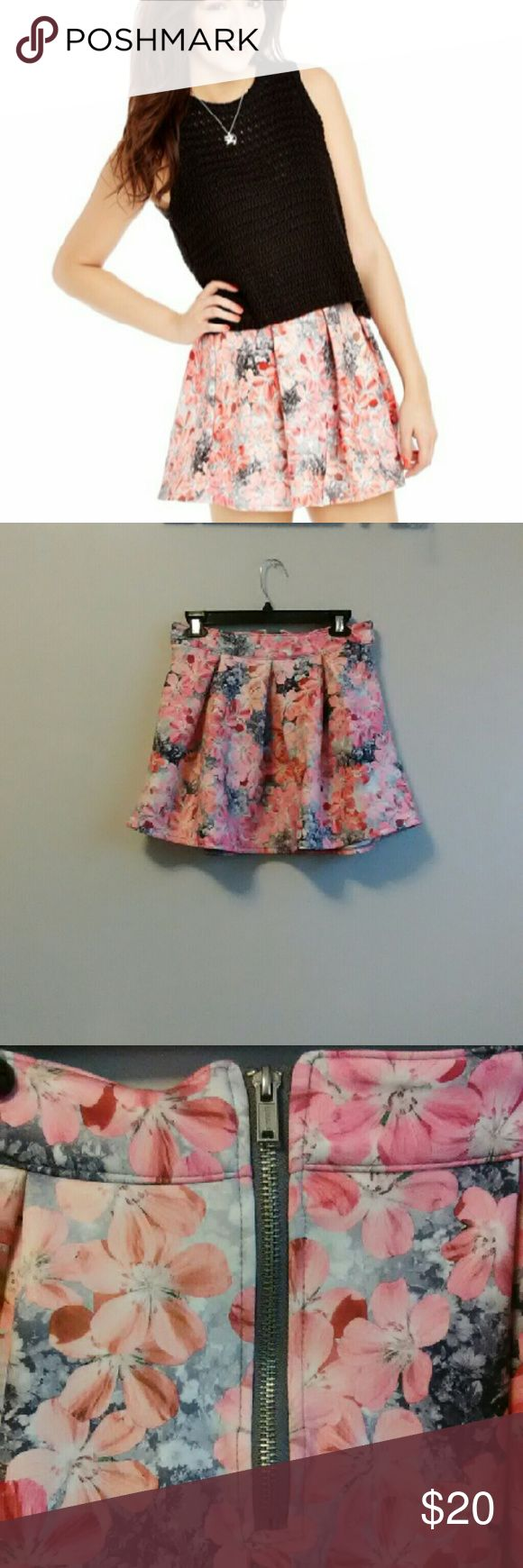 Bethany Mota Floral Skirt! In excellent condition!! Never Worn!  Medium 92% Polyester 8% Spandex Cute, fun, flirty skater skirt!! Zipper on back.  --Please No Low Ballers. --Funds go towards nursing degree!  Have a nice day!(: Aeropostale Skirts Mini