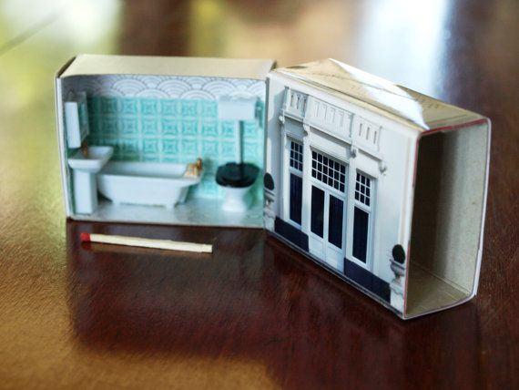 A large matchbox is given a makeover to become a cute little room that can fit in your hand. Photographs cover the box and tiny furniture is inside. A tiny bathroom with art-deco tiles, bathtub, toilet and basin in 1/48th scale.    Measures 7cm wide, 5.5cm tall and 2.8cm deep when closed. A lot of love has gone into the making of our dollhouses and each is a totally unique upcycled piece. They are significantly handmade and as such have their own personality and imperfections. Young people…