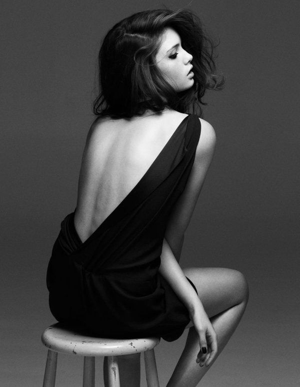 Love the background black and white and simple black dress - great pose