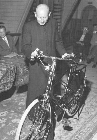 priest with a Juncker 1954