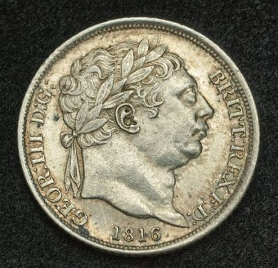 Great Britain Sixpence - 6 Pence Silver Coin of 1816 issued under King George III. The sixpence, known colloquially as the tanner, or half-shilling, was a British pre-decimal coin, worth six (pre - 1971) pence, or 1/40th of a pound sterling.  Obverse: Laureated bust of George III right. Date (1816) below.