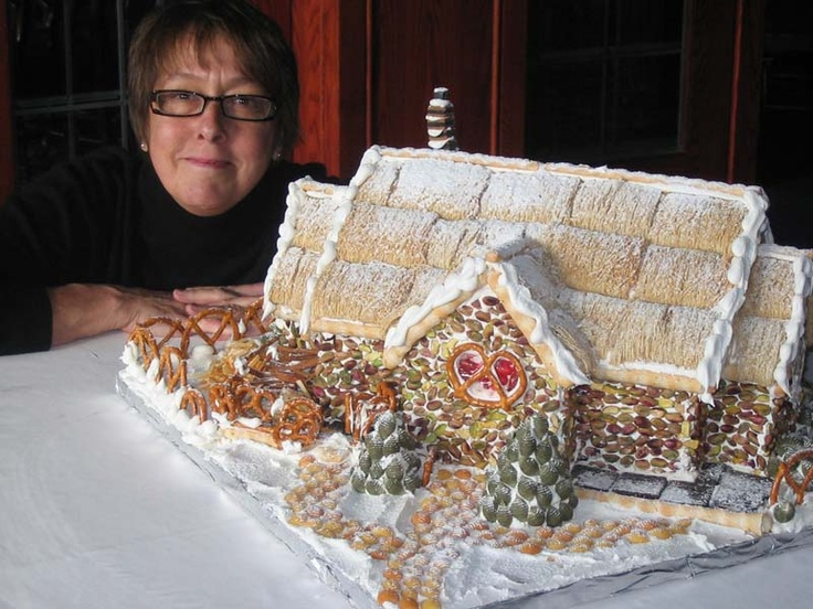Chef Gail Hall with the gingerbread house she created for Christmas in November at Jasper Park Lodge in November 2006.