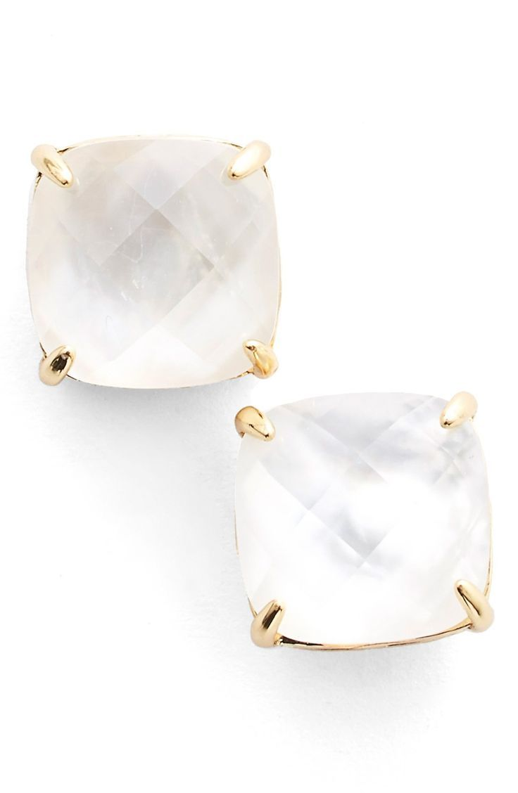 Stunning Kate Spade stud earrings in mother-of-pearl and gold.