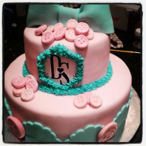 Red velvet cream cheese with fondant bridal shower cake. Buttons and bows