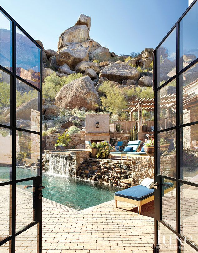 THE PATIO -  Telluride stone, granite and reclaimed brick were chosen for their texture, shapes and hues that appear aged. Plant specimens that played to the mountain's terrain and flora were harvested from the couple's old home.
