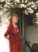 Joan Hickson standing in the doorway of her home in Rose Lane, Wivenhoe (photograph by Sue Murray (ARPS)
