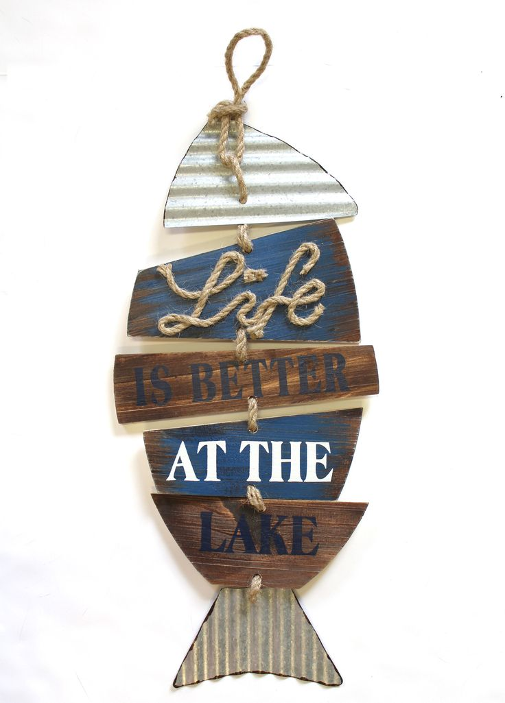 This sign is made out of wood and metal for a fun rustic combo. The twine is tied to each piece and links all the components together to make a fish shape. It is a great sign for the lake cabin or boa