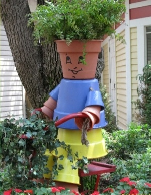 Garden flower pot man...can be made with plastic flower pots...love it.