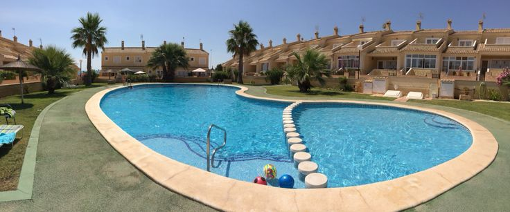 Poolside at the house in Punta Prima, Spain.
