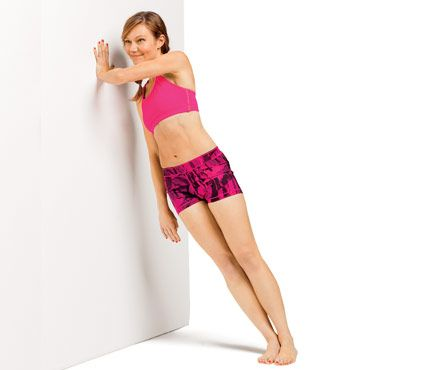 Tone Your Whole Bod With a Wall: Stand with right side to wall, feet together, left arm fully extended at shoulder height with hand on wall. Engage abs and slowly bend left elbow 90 degrees (as shown). Pause; return to start for 1 rep. Do 20 reps. Switch sides; repeat. Works triceps, obliques #SelfMagazine