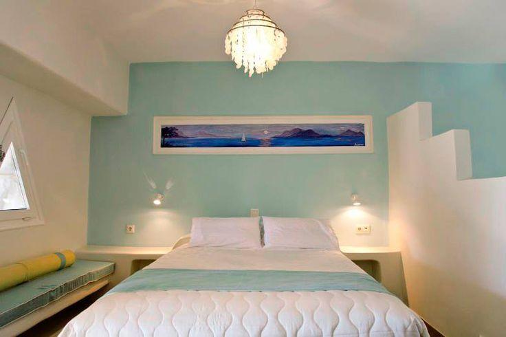 Bed in blue www.aegeancastle.gr