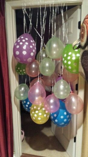 Hanging balloons on the door. I like this alternative to the balloons falling into the room when the door opens. This looks like something our elves would do.