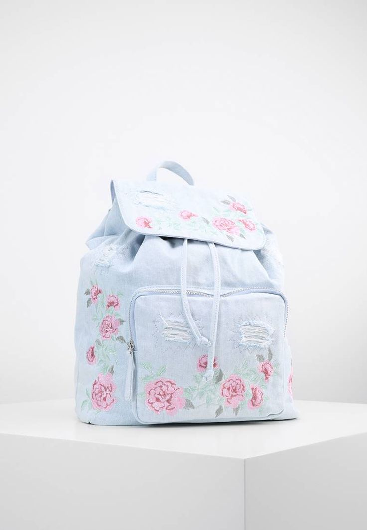 "New Look. Rucksack - light blue. Pattern:floral. Fastening:Magnet. Compartments:mobile phone pocket. length:15.5 "" (Size One Size). width:6.5 "" (Size One Size). Lining:Polyester. carrying handle:4.0 "" (Size One Size). Fabric:Denim..."