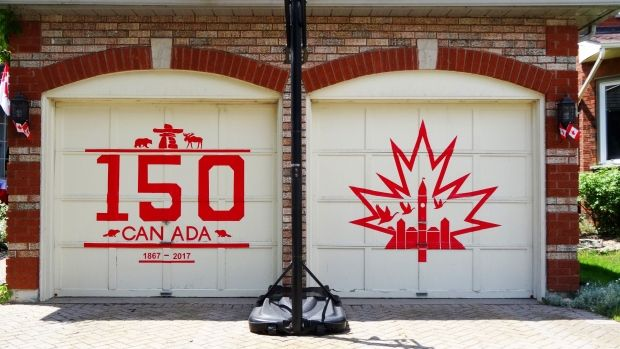 Cambridge woman uses red duct tape to decorate garage doors for Canada Day | After a few days of brainstorming, with the help from her family, Talpak took four rolls of red duct tape and an exacto knife and got to work. (Ingrid Talpak) | CBC . June 26, 2017