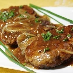 An easy-to-make classic featuring tasty hamburger 'steaks' smothered in gravy and onions. It's a great way to dress up a pound of ground beef, and you probably have all the ingredients on hand!