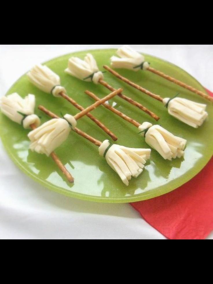 Broom stick snacks Pretzel sticks with string cheese