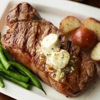 New York Strips with Gorgonzola Butter...SO DELISH!!