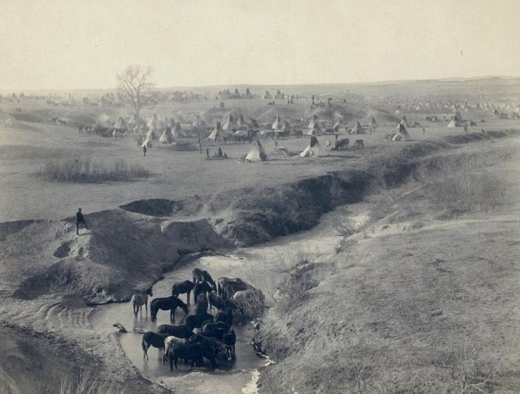 Indian camp: Titled Villa of Brule, this was the home of the Lakota (Sioux) tribe pictured in 1891 near the Pine Ridge reservation with the White Clay Creek watering hole. Released by the U.S. Library of Congress.
