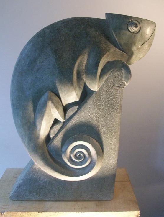 Paul Harvey carved stone chameleon.