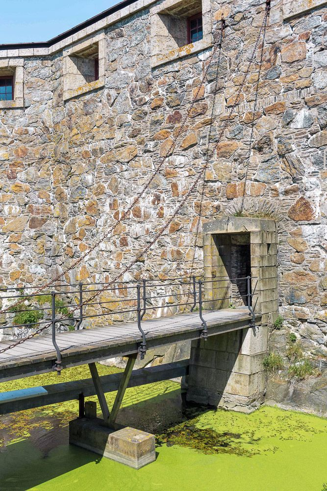 A draw bridge and moat inside of Carlsten Fortress