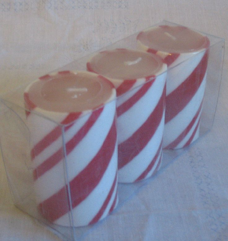Pin by the spicy senior on christmas musical toys for Candy cane holder candle centerpiece
