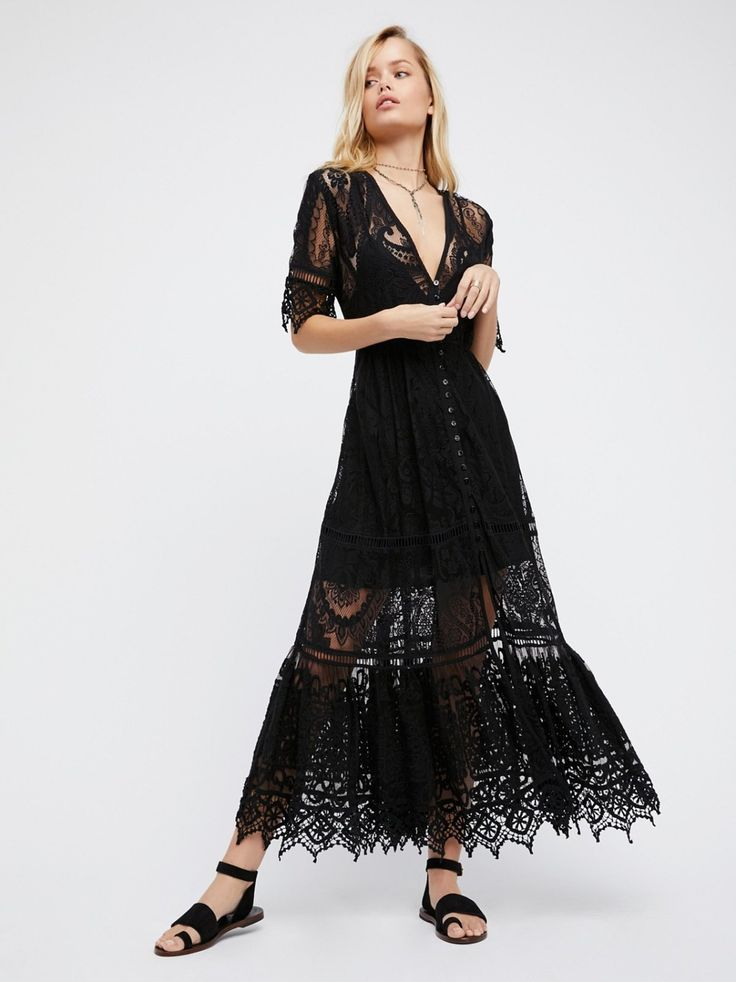 Rhiannon Gown   Flowy maxi dress in a floral crochet lace. This vintage-inspired style is easily dressed up or down. * Short sleeves * Button down front * Tapered waist * Tired skirt * Comes with a removable slip with adjustable straps