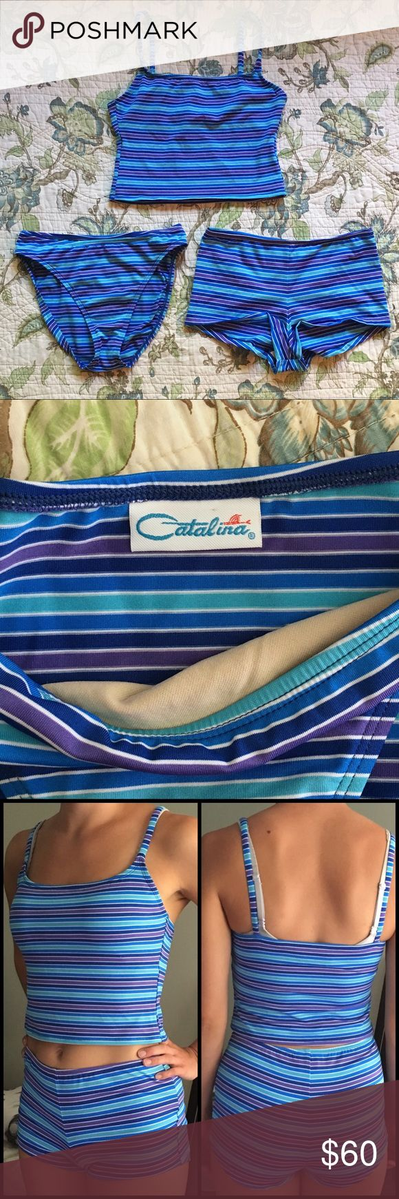 "Vintage 90s striped swimsuit set Vintage 90s striped swimsuit set. Purple blue and white striped matching tankini set. The set comes 1 tankini tank top and 2 swim bottoms one being high cut bikini bottoms and the other being high waisted swim shorts. The top has a built in shelf bra, both bottoms are fully lined in the front. Perfect condition. Model is a 34B, 26"" to 27"" waist and wears a size 9 in jeans. Measurements are taken laying flat: armpit to armpit: 15"" length: 16"" Vintage Swim…"