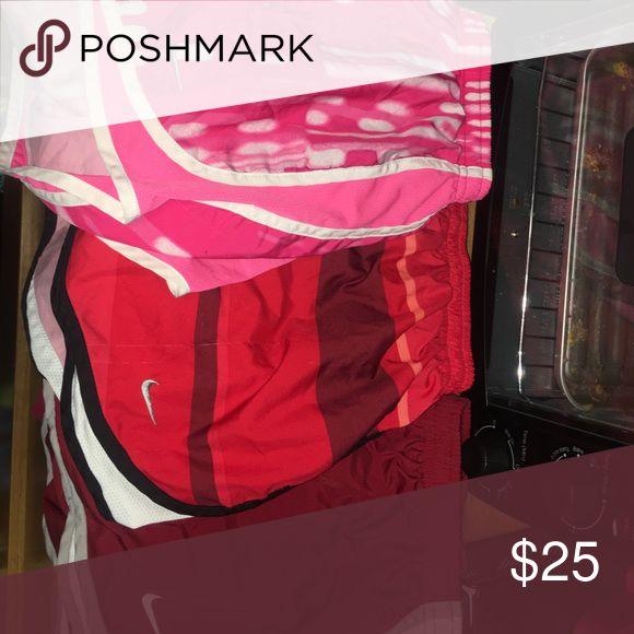 3 pairs of Nike shorts Pink, red, and maroon shorts Nike Shorts