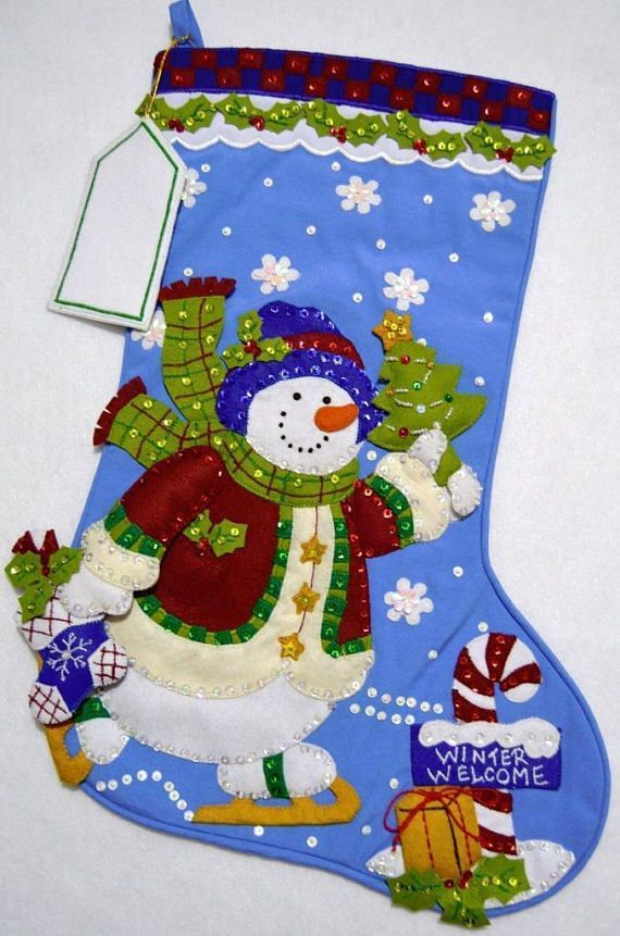 This wonderful Christmas Stocking made from a Bucilla kit called Skating Snowman is made of felt appliqué on cloth and beautifully decorated with hand sewn sequins and beads. Frosty has on his winter coat skating on the ice with a Christmas tree in one hand and stocking in the