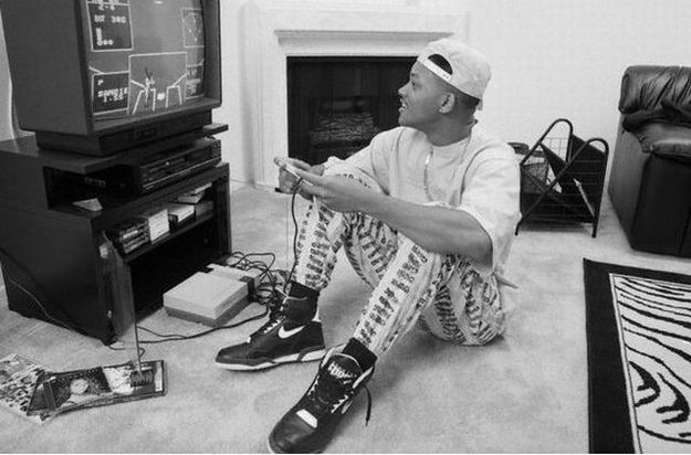 Will Smith playing Nintendo in a backwards hat, on a zebra rug, wearing Nike Air's, zubaz pants, and a Mariah Carey cd on the ground: #90skidprobs