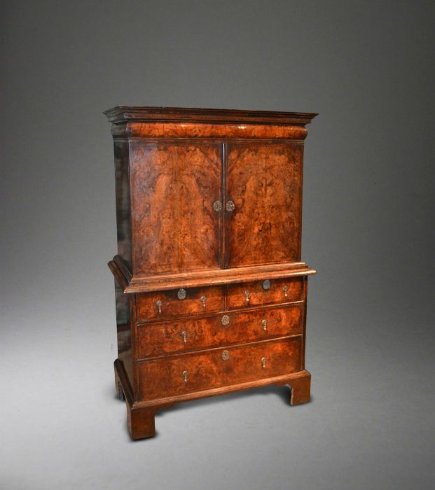 A small Queen Anne walnut cabinet on chest.