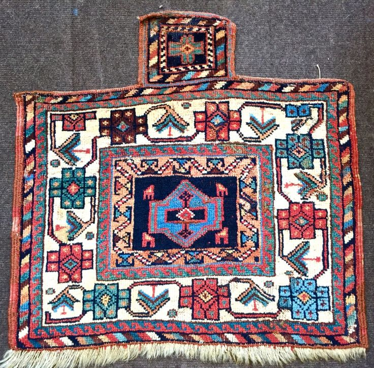 Lovely antique Afshar salt bag ca 1880 size 59 X 58 cm. All wool and natural dyes few small old flat stitch repairs and some old moth damage but it is now  ...